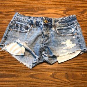 AE Light washed distressed short shorts